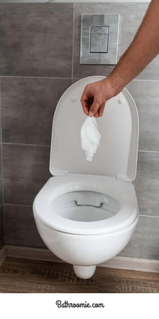 Wipe the bathroom floor clean with a tissue
